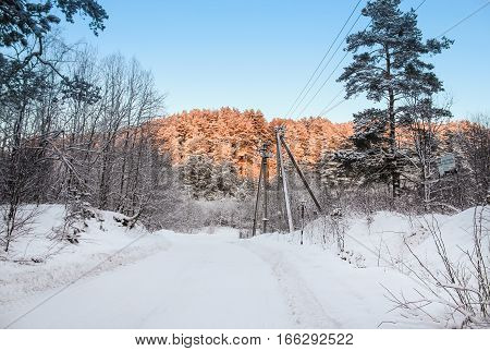 Winter landscape at sunset. Winter night scenery and countryside views of the sunset.
