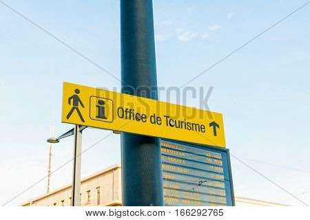 Office de Tourisme translates as Tourism Office with icon pictogram in central city of Mulhouse France