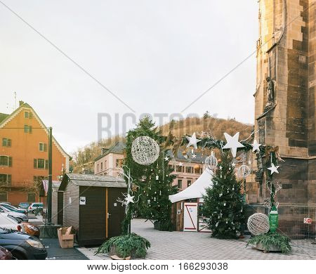 THANN FRANCE - DEC 12 2015: Empty Christmas Market in Thann village - in the place of the St. Thiebault Collegiate - Eastern France Aslace