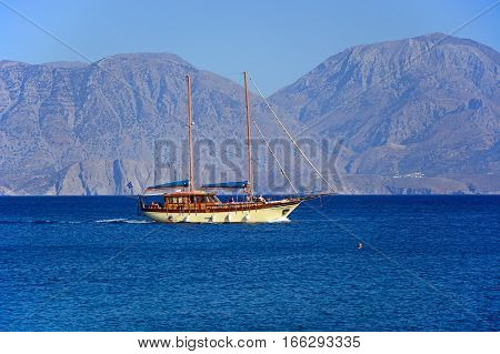 AGIOS NIKOLAOS, CRETE - SEPTEMBER 17, 2016 - Large yacht with two masts in the bay with mountains to the rear Agios Nikolaos Crete Greece Europe, September 17, 2016.