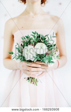Beauty wedding bouquet in bride's hands. Wedding concept