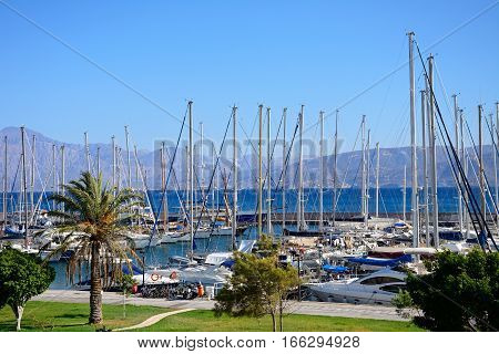 AGIOS NIKOLAOS, CRETE - SEPTEMBER 17, 2016 - View of yachts in the marina with mountains to the rear Agios Nikolaos Crete Greece Europe, September 17, 2016.