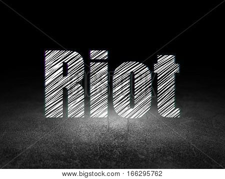 Politics concept: Glowing text Riot in grunge dark room with Dirty Floor, black background