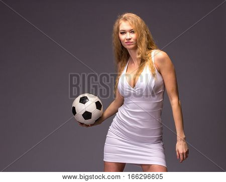 Young Woman In White Evening Dress With Soccer Ball