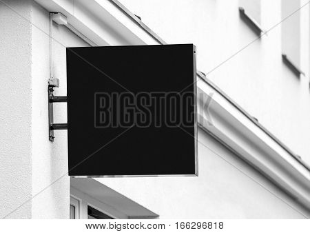 Black empty outdoor business signage mockup to add company logo