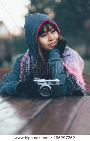 Fashionable female photographer in cold weather wearing colorful scarf