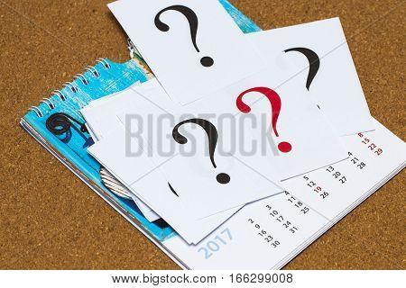 Closeup Shot Of A Lot Of Paper With Question Mark. Calendar