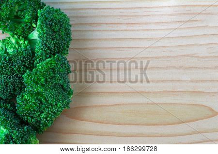 Fresh broccoli on the wooden table, Broccoli with copy space