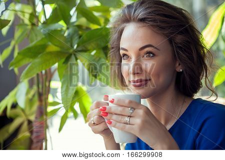 Beautiful Woman Drinking Coffe In A Cafe