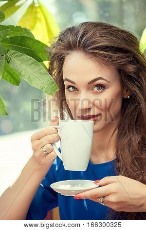 Beautiful Girl Drinking Coffe In A Cafe