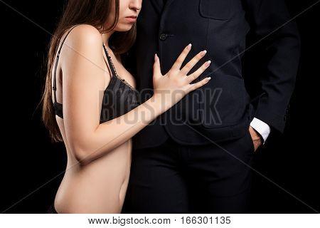 Woman In Bra Embracing A Businessman