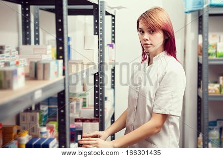 Pharmacist Woman In The Warehouse
