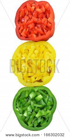 Slices of red bell pepper, green and yellow colors, filled with finely chopped pulp, lined up vertically in form of traffic light. Isolated on white background