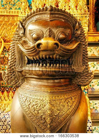 Guardian daemon dogs on entrance of kings palace Bangkok, Thailand