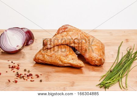 Smoked Or Grilled Chicken (thighs) Lie On The Board.