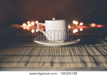 cup of coffee standing on a bamboo napkin