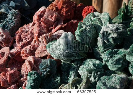 Multicolor desert rose. Crystal sand and gypsum