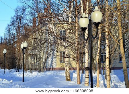 Pedestrian street in small northern provincial Russian town on sunny winter frosty day