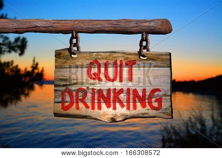 quit drinking motivational phrase sign on old wood with blurred background