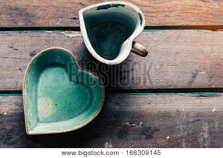 Saucer and cup of coffee on the old wooden floor.