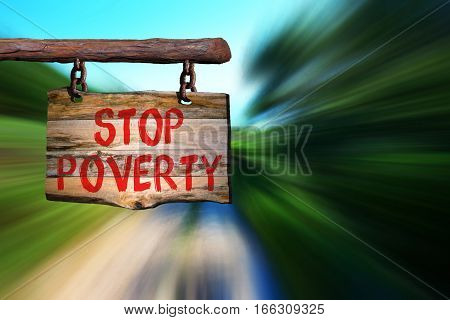 stop poverty motivational phrase sign on old wood with blurred background