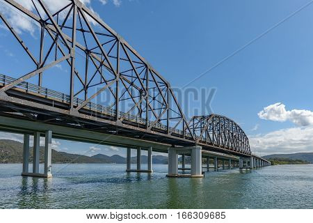 Old and new bridges across the Hawkesbury River at Mooney Mooney in New South Wales Australia.