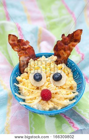 Scrambled eggs funny bunny for Easter breakfast