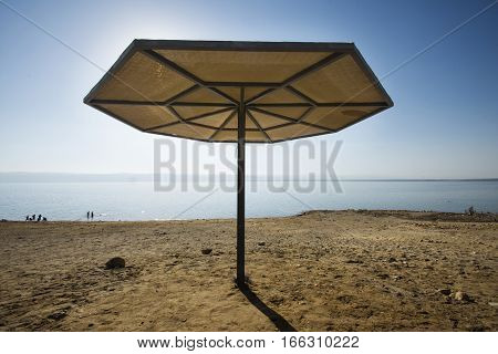 Tent, stand, canopy in Dead sea beach from Jordan to Palestine