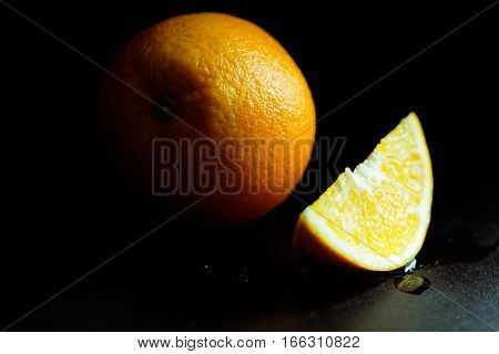 Oragne and side of orange with moody and dark style and background