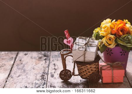 Heart and gift box on a wooden cart.