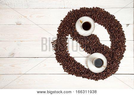 Coffee Background. Heap Roasted Coffee Beans In Shape Of Yin Yan
