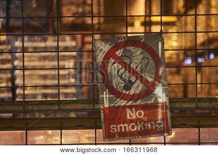 No Smoking sign inside a factory. Smoke free