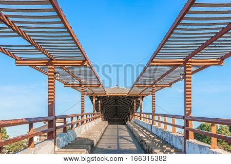 a public bridge at Samchuk Market with a blue sky background.