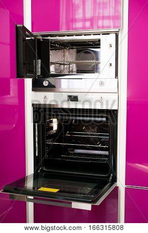 Detail of modern bright pink kitchen.Interior unit