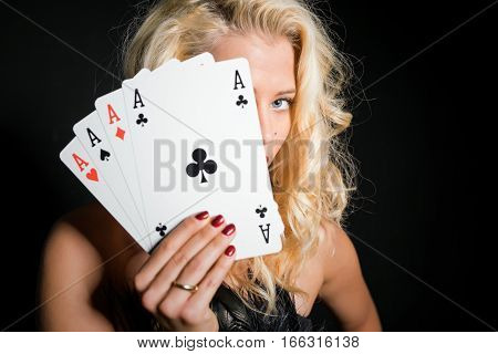 Woman hiding behind huge size  poker cards