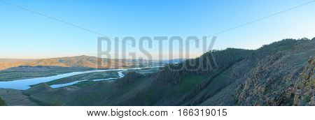Beautiful panorama of the mountains and a winding river