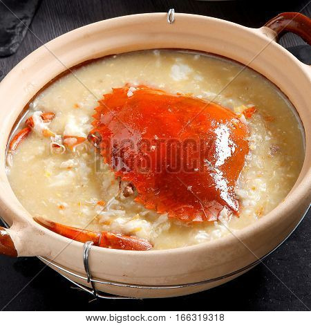 Congee With Whole Crab In Clay Pot