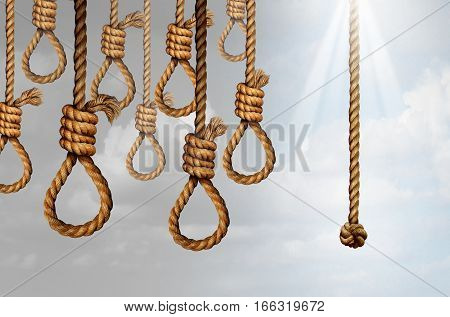 Despair and hope concept as a group of deadly hanging noose knots representing desperate suicidal psychological misery with one individual straight rope as a positive helpful liberation symbol.