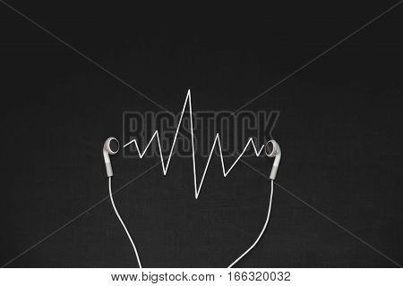 The photo of headphones on a black background