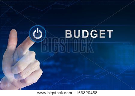 double exposure business hand clicking budget button with blurred background