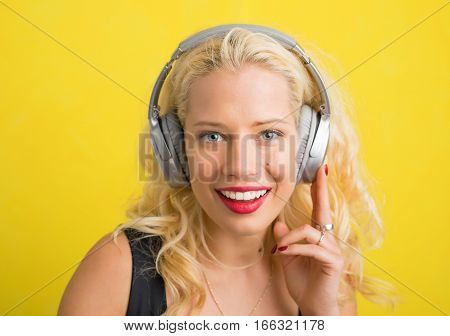 Woman with wireless headphones listening to music
