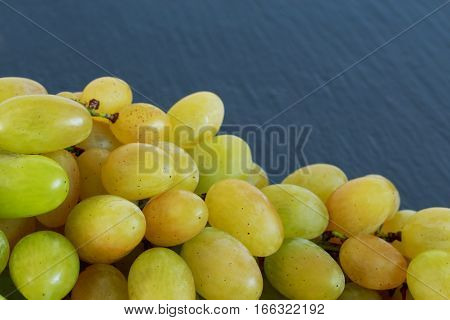 the bunch of grapes on a black background