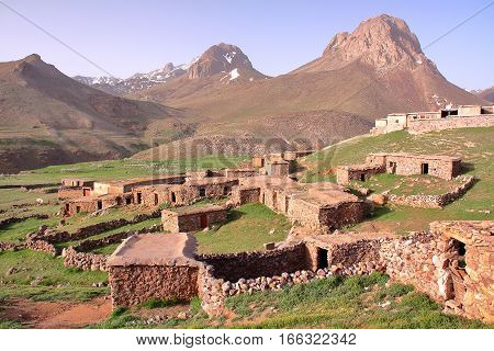 MOROCCO: Sheepfold close to Sirwa peak in the Atlas mountains with Berber architecture