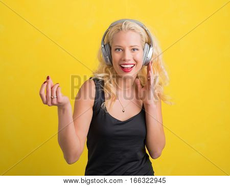 Happy Woman enjoying music on wireless headphones