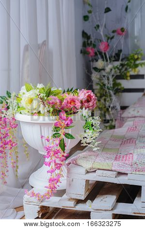 decor of floral bouquets in Interior in rustic style