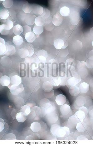 silver Christmas garland blurred bokeh polygon shape bokeh