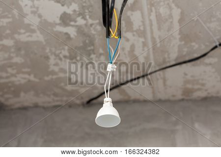 Energy saving lamp on the ceiling. Ceiling light. The repair process.