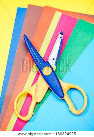 Close-up view of scissors on colorful paper