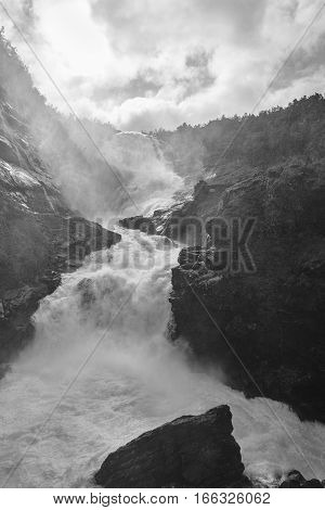 Kjosfossen dramatic waterfall in Norway. Flam Myrdal railway highlight landscape. Vertical