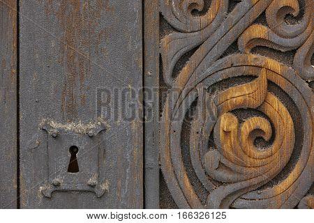 Norwegian ancient wooden carved door with lock. Heddal church. Norway